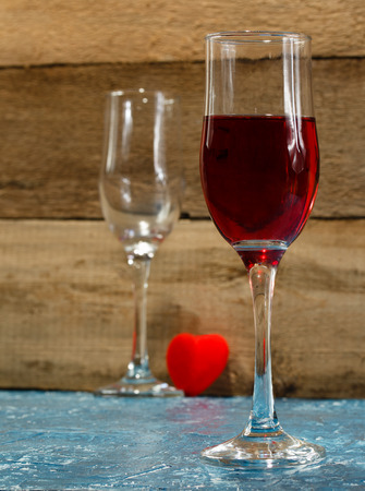lovers quarrel: Valentines Day. Quarrel between a pair of lovers. He left without drinking glass. Concept