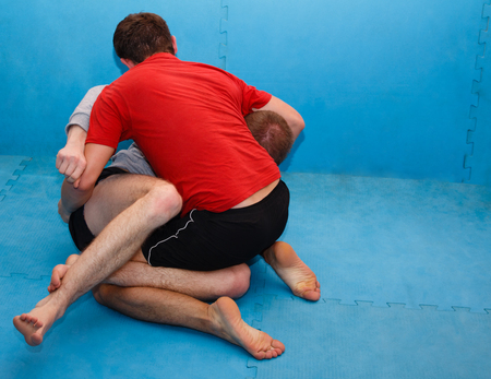 folkstyle: Wrestlers. Two men fighting on the mat. Stock Photo
