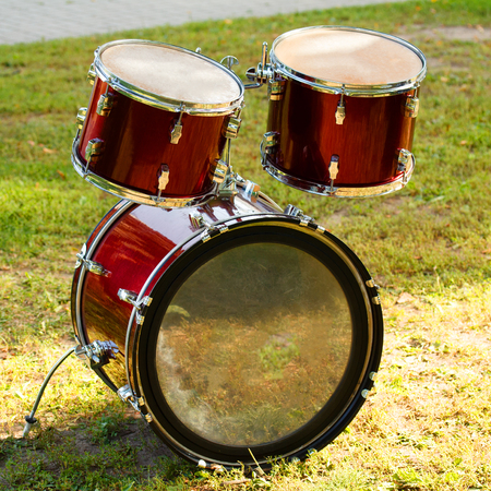 Drum kit setted on the grass in summer