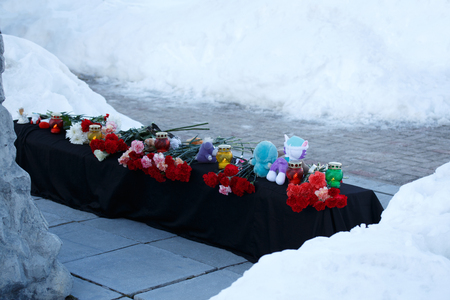 Winter, snow. A mourning memorial with flowers and toys after disaster with the victims Stok Fotoğraf