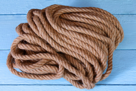 A jute rope on a blue wooden background