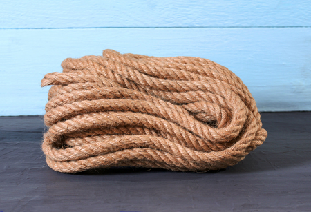 A natural jute rope on blue background Stock Photo