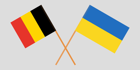 Crossed Ukraine and belgium flags. Official colors. Correct proportion. Vector illustration