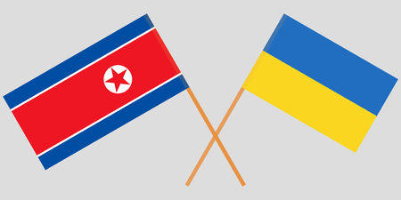 Crossed flags Ukraine and North Korea. Official colors. Correct proportion. Vector illustration