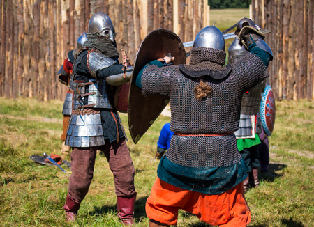 Reconstruction. Two medieval warriors in armor are fighting