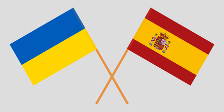 Spain and Ukraine. The Spanish and Ukrainian flags. Official proportion. Correct colors. Vector illustration