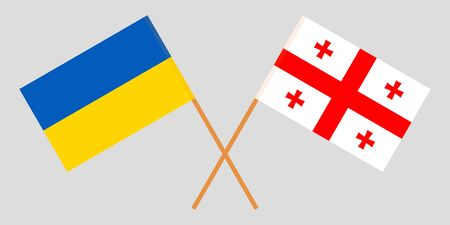 Georgia and Ukraine. Crossed Georgian and Ukrainian flags. Official colors. Correct proportion. Vector illustration