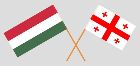 Georgia and Hungary. Crossed Georgian and Hungarian flags. Official colors. Correct proportion. Vector illustration