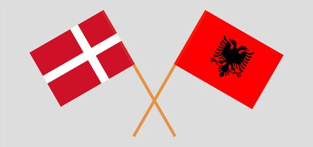 Albania and Denmark. Crossed Albanian and Danish flags. Official colors. Correct proportion. Vector illustration