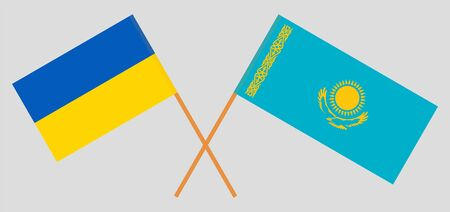 Crossed flags of Kazakhstan and the Ukraine. Official colors. Correct proportion. Vector illustration