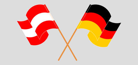 Crossed and waving flags of Austria and Germany.