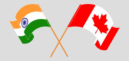 Crossed and waving flags of India and Canada. Vector illustration
