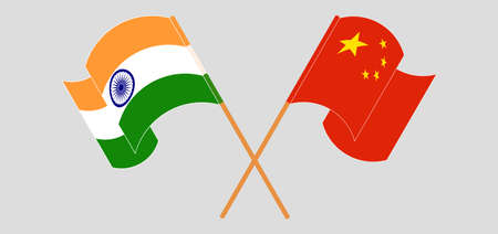 Crossed and waving flags of India and China. Vector illustration