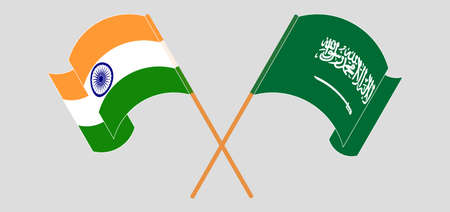 Crossed and waving flags of India and the Kingdom of Saudi Arabia. Vector illustration