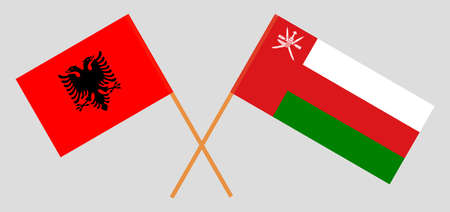 Crossed flags of Oman and Albania. Official colors. Correct proportion.  イラスト・ベクター素材