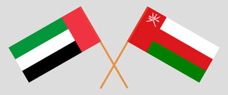 Crossed flags of Oman and the United Arab Emirates. Official colors. Correct proportion.