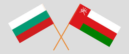 Crossed flags of Oman and Bulgaria. Official colors. Correct proportion.
