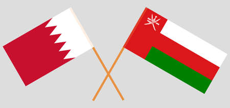 Crossed flags of Oman and Bahrain. Official colors. Correct proportion.