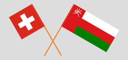 Crossed flags of Oman and Switzerland. Official colors. Correct proportion.