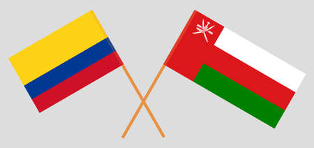 Crossed flags of Oman and Colombia. Official colors. Correct proportion.