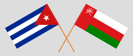Crossed flags of Oman and Cuba. Official colors. Correct proportion.