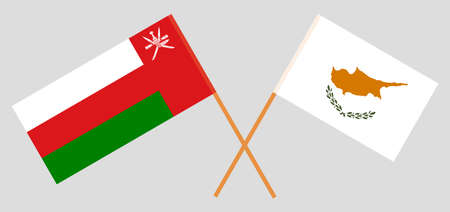 Crossed flags of Oman and Cyprus. Official colors. Correct proportion.