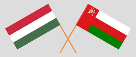 Crossed flags of Oman and Hungary. Official colors. Correct proportion.