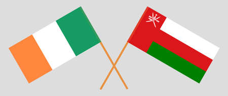 Crossed flags of Oman and Ireland. Official colors. Correct proportion.