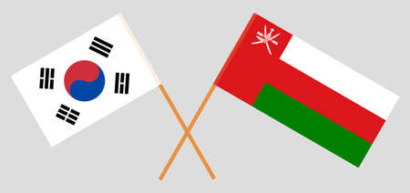 Crossed flags of Oman and South Korea. Official colors. Correct proportion.