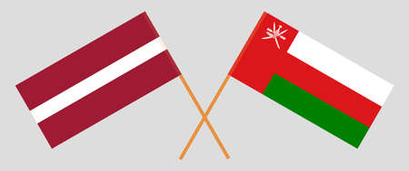 Crossed flags of Oman and Latvia. Official colors. Correct proportion.
