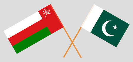 Crossed flags of Oman and Pakistan. Official colors. Correct proportion.