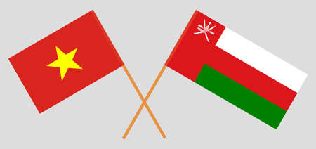 Crossed flags of Oman and Vietnam. Official colors. Correct proportion.