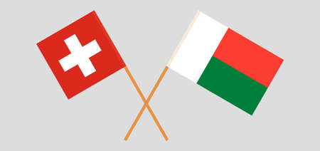 Crossed flags of Madagascar and Switzerland. Official colors. Correct proportion.