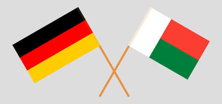 Crossed flags of Madagascar and Germany. Official colors. Correct proportion.