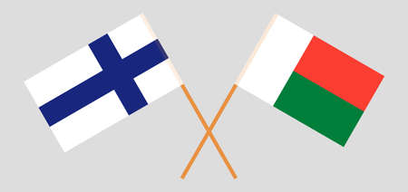 Crossed flags of Madagascar and Finland. Official colors. Correct proportion. Standard-Bild - 155259199