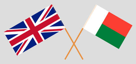 Crossed flags of Madagascar and the UK. Official colors. Correct proportion.