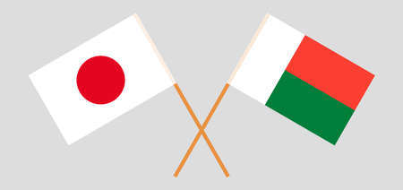 Crossed flags of Madagascar and Japan. Official colors. Correct proportion. Illustration