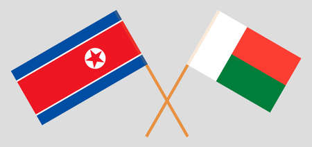 Crossed flags of Madagascar and North Korea. Official colors. Correct proportion. Illustration