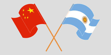 Crossed and waving flags of Argentina and China.