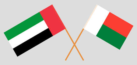 Crossed flags of Madagascar and the United Arab Emirates. Official colors. Correct proportion. Vector illustration