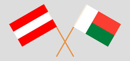 Crossed flags of Madagascar and Austria. Official colors. Correct proportion. Vector illustration