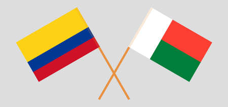Crossed flags of Madagascar and Colombia. Official colors. Correct proportion. Vector illustration