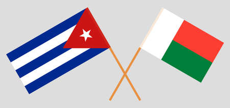 Crossed flags of Madagascar and Cuba. Official colors. Correct proportion. Vector illustration