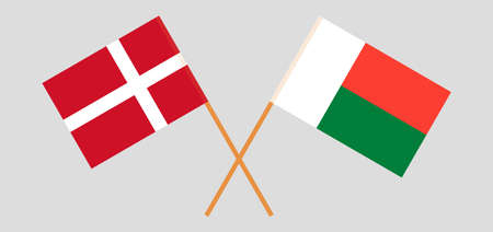 Crossed flags of Madagascar and Denmark. Official colors. Correct proportion. Vector illustration
