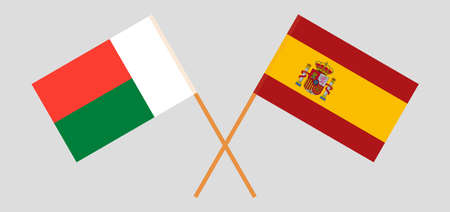 Crossed flags of Madagascar and Spain. Official colors. Correct proportion. Vector illustration