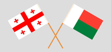 Crossed flags of Madagascar and Georgia. Official colors. Correct proportion. Vector illustration