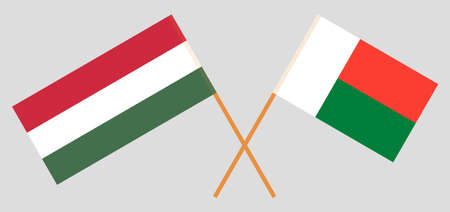 Crossed flags of Madagascar and Hungary. Official colors. Correct proportion. Vector illustration