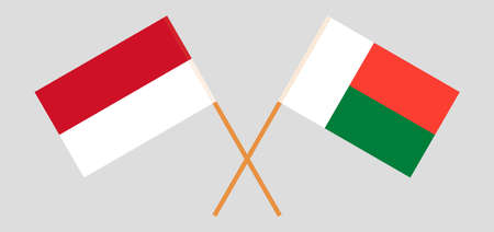 Crossed flags of Madagascar and Indonesia. Official colors. Correct proportion. Vector illustration