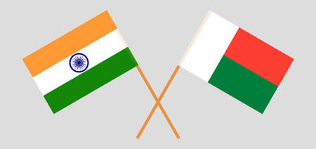 Crossed flags of Madagascar and India. Official colors. Correct proportion. Vector illustration