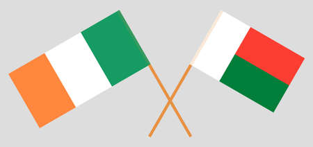 Crossed flags of Madagascar and Ireland. Official colors. Correct proportion. Vector illustration